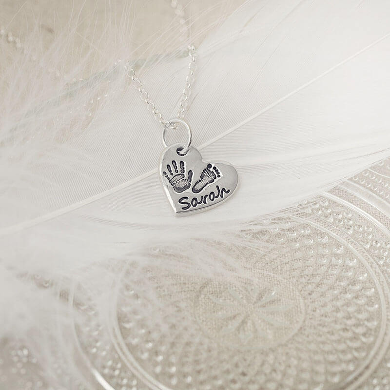 small hand on heart necklace